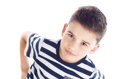 El muchacho guarda sus manos en caderas Imagen de archivo libre de regalías