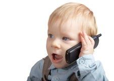El muchacho habla por el teléfono Fotos de archivo libres de regalías