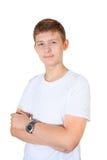 El muchacho hermoso en la camiseta y el reloj blancos con su mano aisló o Foto de archivo libre de regalías