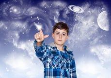El muchacho isTouching al espacio Fotografía de archivo