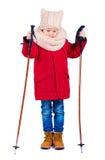 El muchacho joven, niño con el esquí se pega en fondo aislado Fotos de archivo libres de regalías