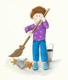 El muchacho limpia las hojas Fotografía de archivo