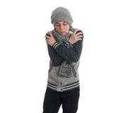 El muchacho lindo del adolescente en suéter gris sobre blanco aisló el fondo Foto de archivo