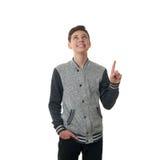 El muchacho lindo del adolescente en suéter gris sobre blanco aisló el fondo Fotografía de archivo