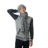 El muchacho lindo del adolescente en suéter gris sobre blanco aisló el fondo Imágenes de archivo libres de regalías