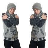 El muchacho lindo del adolescente en suéter gris sobre blanco aisló el fondo Fotos de archivo