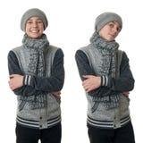 El muchacho lindo del adolescente en suéter gris sobre blanco aisló el fondo Imagen de archivo libre de regalías