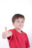 El muchacho muestra una muestra   Imagenes de archivo
