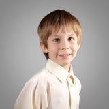 El muchacho poco sistema atractivo emocional hace caras Imagenes de archivo
