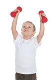 El muchacho preescolar hace ejercicios de la mañana Foto de archivo