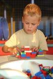 El muchacho que juega Foto de archivo libre de regalías
