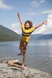 El muchacho salta Fotografía de archivo libre de regalías