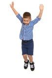 El muchacho salta arriba Imagenes de archivo