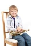 El muchacho se sienta Fotografía de archivo libre de regalías