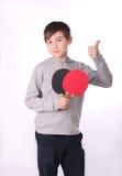 El muchacho y el ping-pong Fotografía de archivo