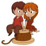 El muchacho y la muchacha se están sentando con forma del corazón en el fondo blanco Imagen de archivo libre de regalías