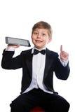 El muchacho y la tableta listos, aislados fotos de archivo
