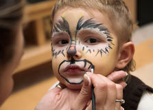 El muchacho y un maquillaje Imágenes de archivo libres de regalías