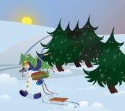 El muñeco de nieve está recorriendo a través del bosque Foto de archivo libre de regalías