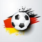El mundo del fútbol o el campeonato europeo con la bola y Alemania señala colores por medio de una bandera Imágenes de archivo libres de regalías
