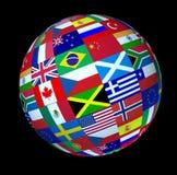 El mundo global señala la esfera por medio de una bandera Fotos de archivo libres de regalías