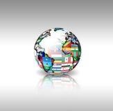 El mundo señala la esfera por medio de una bandera Foto de archivo