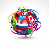 El mundo señala la esfera por medio de una bandera Imagen de archivo