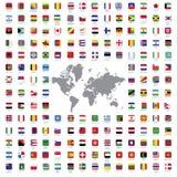El mundo señala todos por medio de una bandera Foto de archivo