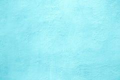 El muro de cemento del color azul claro, turquesa de la textura cementa detrás Fotografía de archivo