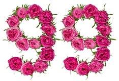 El número árabe 99, noventa y nueve, de las flores rojas de subió, isolat Imagenes de archivo