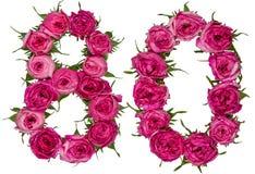 El número árabe 80, ochenta, de las flores rojas de subió, aislado encendido imagenes de archivo