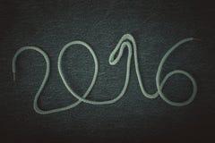 El número 2016 de cuerda en el fondo del frente del je Fotografía de archivo libre de regalías