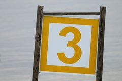 El número tres en un complejo playero Fotografía de archivo libre de regalías