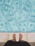 El nadar en dinero Fotografía de archivo libre de regalías