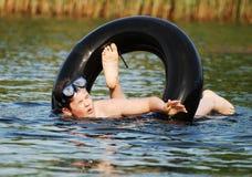 El nadar en el tubo Imagen de archivo libre de regalías