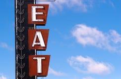 El neón come el letrero retro de Route 66 de la comida de la publicidad de la muestra Imágenes de archivo libres de regalías