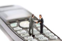 El negocio modelo figura el teléfono A Imágenes de archivo libres de regalías