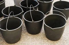 El negro buckets los cubos Foto de archivo libre de regalías