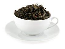 El negro deja té en taza Imágenes de archivo libres de regalías