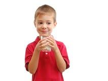 El niño bebe la leche Fotografía de archivo libre de regalías