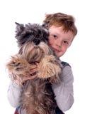 El niño con un perro Imagen de archivo libre de regalías