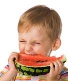 El niño con una sandía Foto de archivo