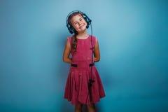 El niño de la muchacha del aspecto de diez europeos en a Fotografía de archivo
