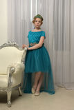 El niño de la muchacha en el vestido atractivo Imágenes de archivo libres de regalías