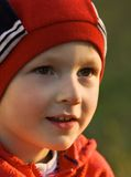 El niño en el sol Fotografía de archivo libre de regalías