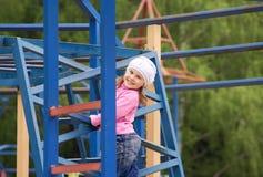 El niño en un playgroud Fotografía de archivo