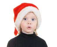 El niño en un sombrero Papá Noel foto de archivo