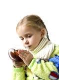 El niño es enfermo con la taza de té Imágenes de archivo libres de regalías