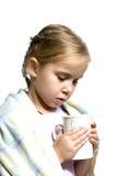El niño es enfermo con la taza de té Fotos de archivo libres de regalías