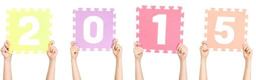 El niño está sosteniendo 2015, concepto del Año Nuevo Fotografía de archivo
